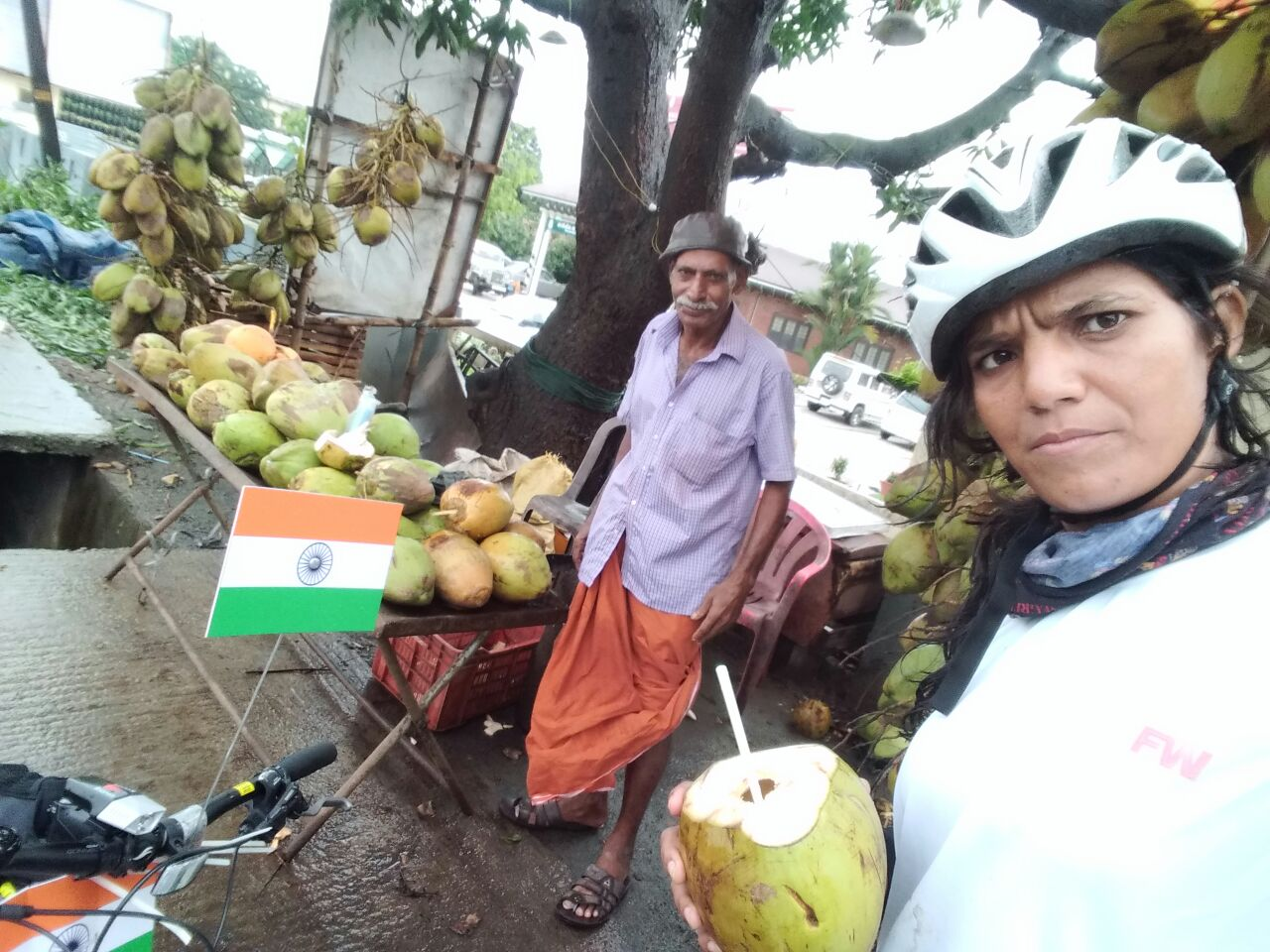 cycle expedition enjoying coconut water