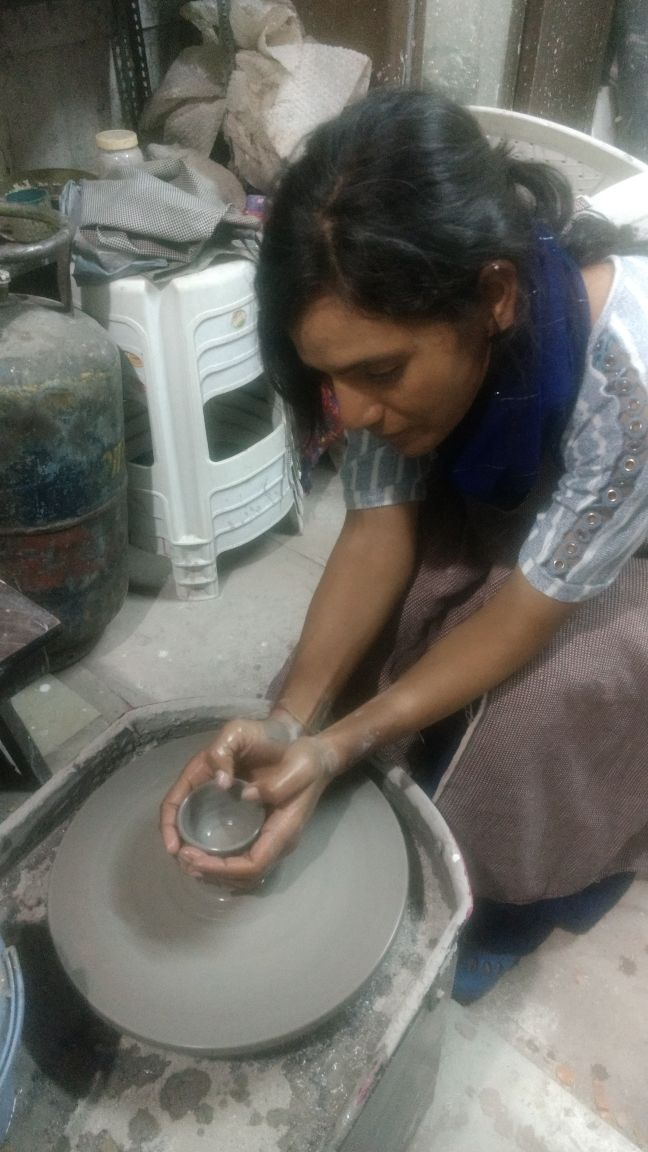 Sunita enjoying pottery